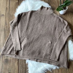Knit turtleneck sweater with pouch pockets